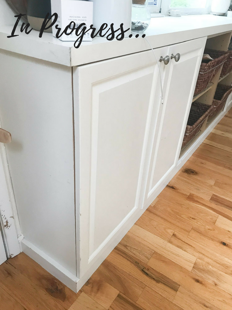 White cabinet doors with steel knobs.