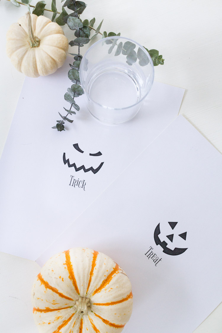 Trick or Treat Stickers for candles lying on the counter.