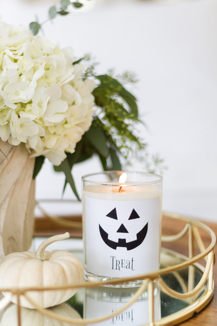Glass candle with the treat sticker on it.