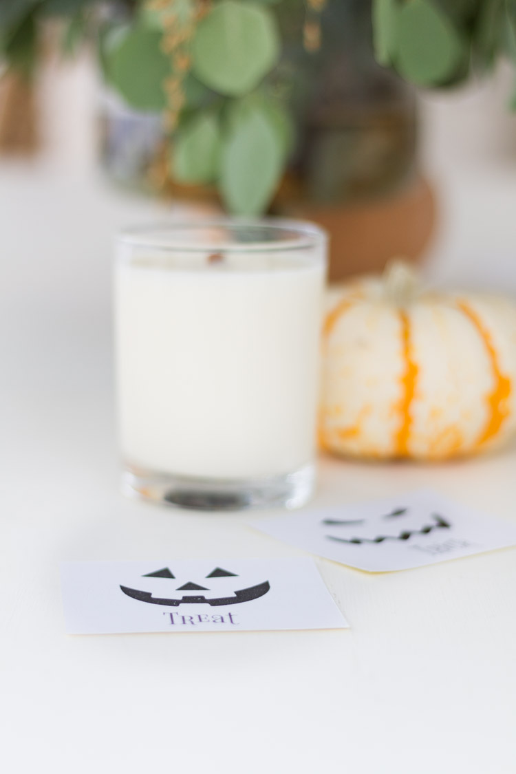 The trick or treat stickers on the counter by the candle.
