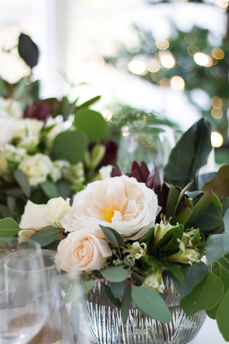 Peonies and roses as a centerpiece on the table.