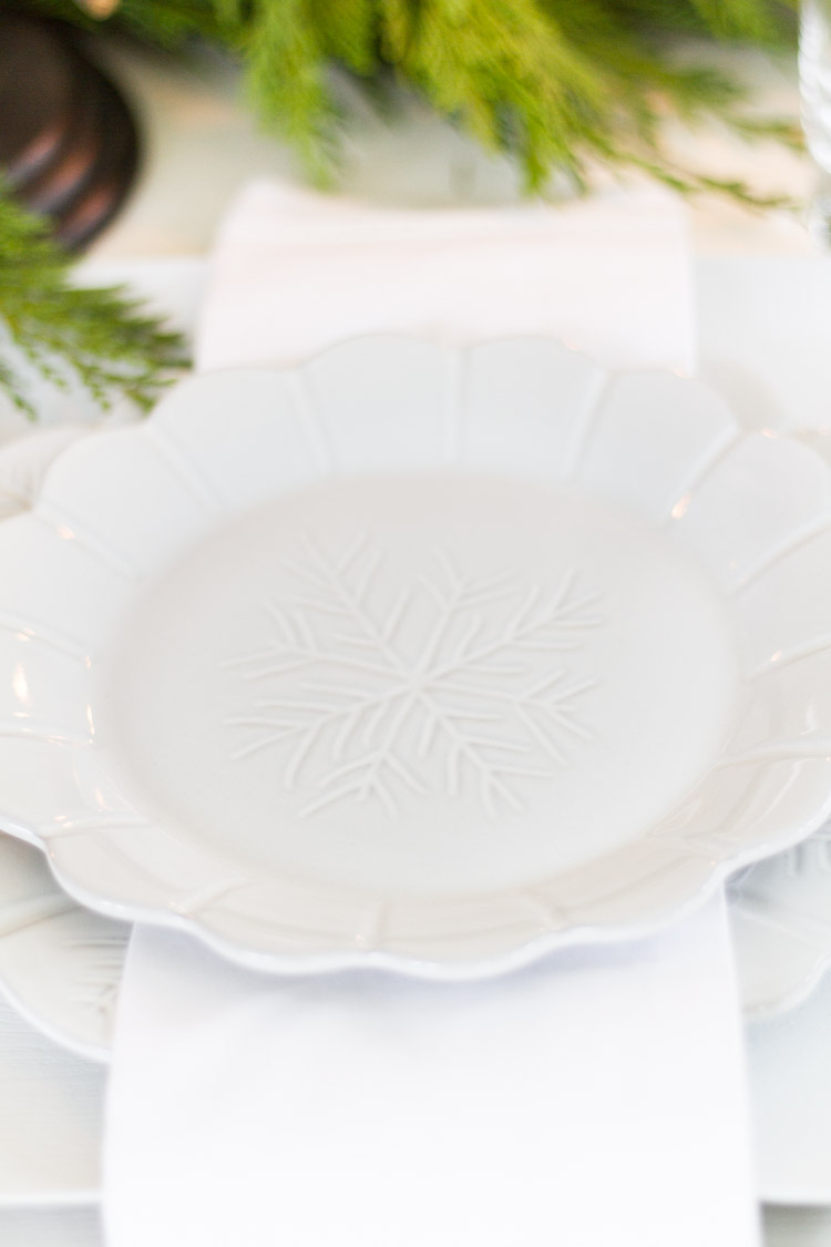 A white plate with a snowflake carved in the plate.
