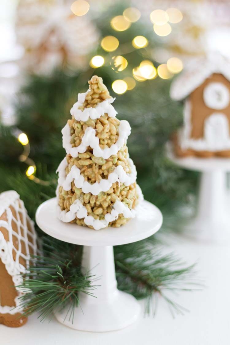 A white mini cake stand with a Rice Krispie tree on it.